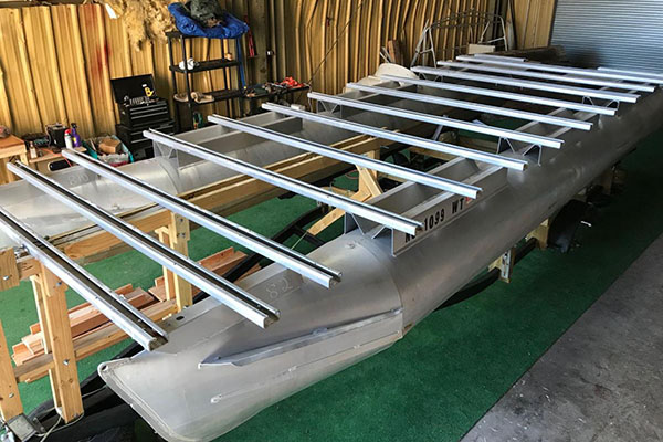 Local group working on prototype boat for electric pontoon design