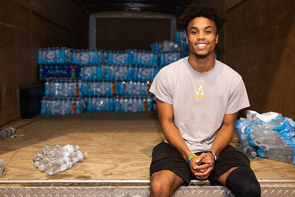 Appalachian student teams up with staff to deliver bottled water for hurricane relief
